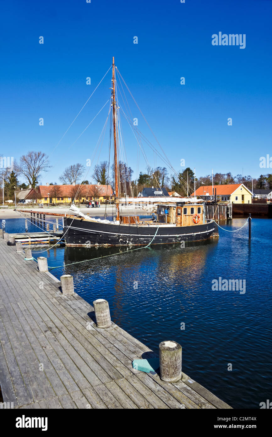 Roervig harbour in north Sealand Denmark with old fishing boat - Stock Image