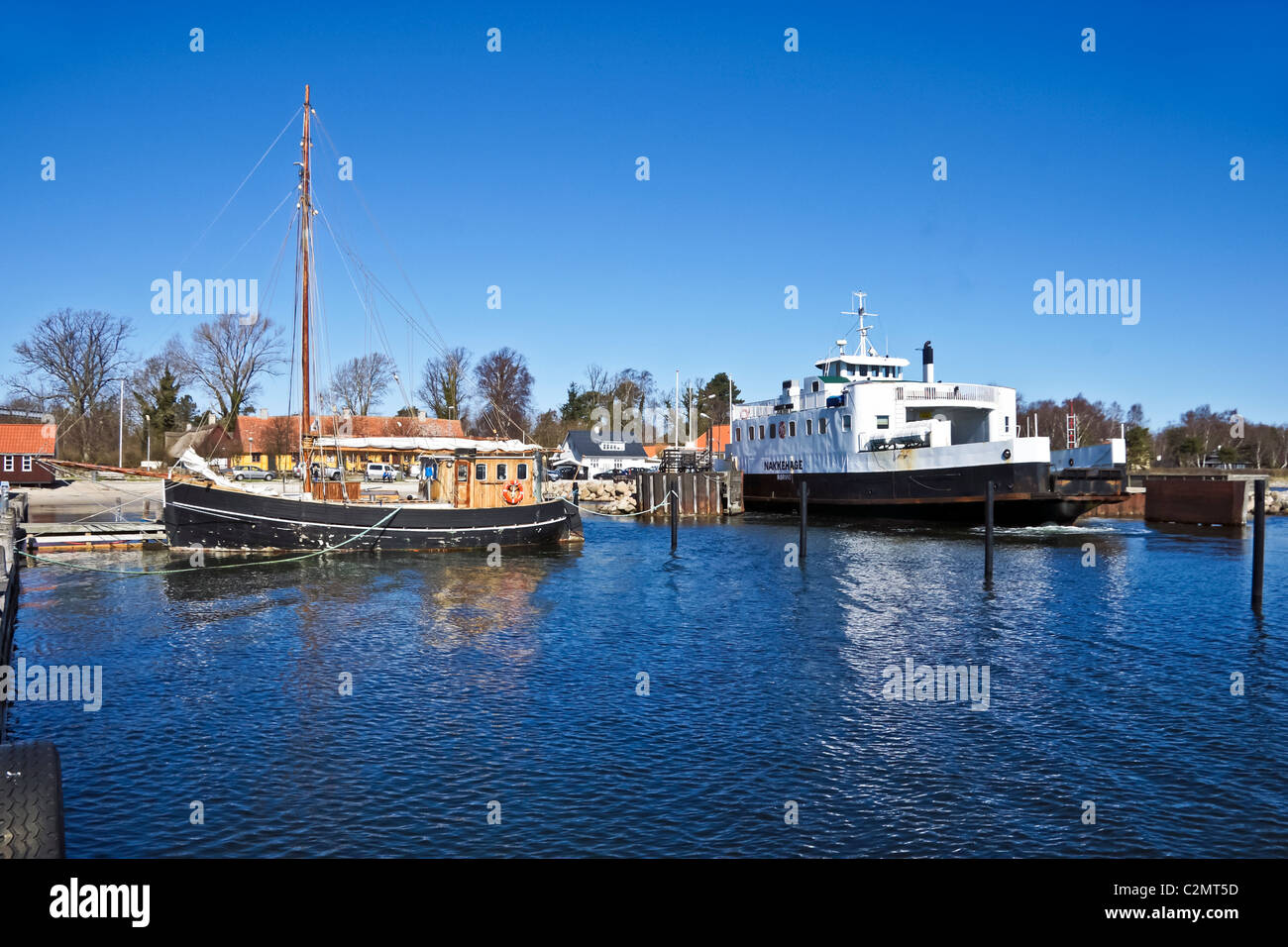 Danish car and passenger ferry Nakkehage is arriving at its berth in Roervig on Sealand in Denmark - Stock Image