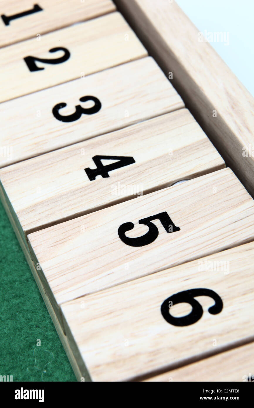 Numbers 1-6 on a wooden board game - Stock Image