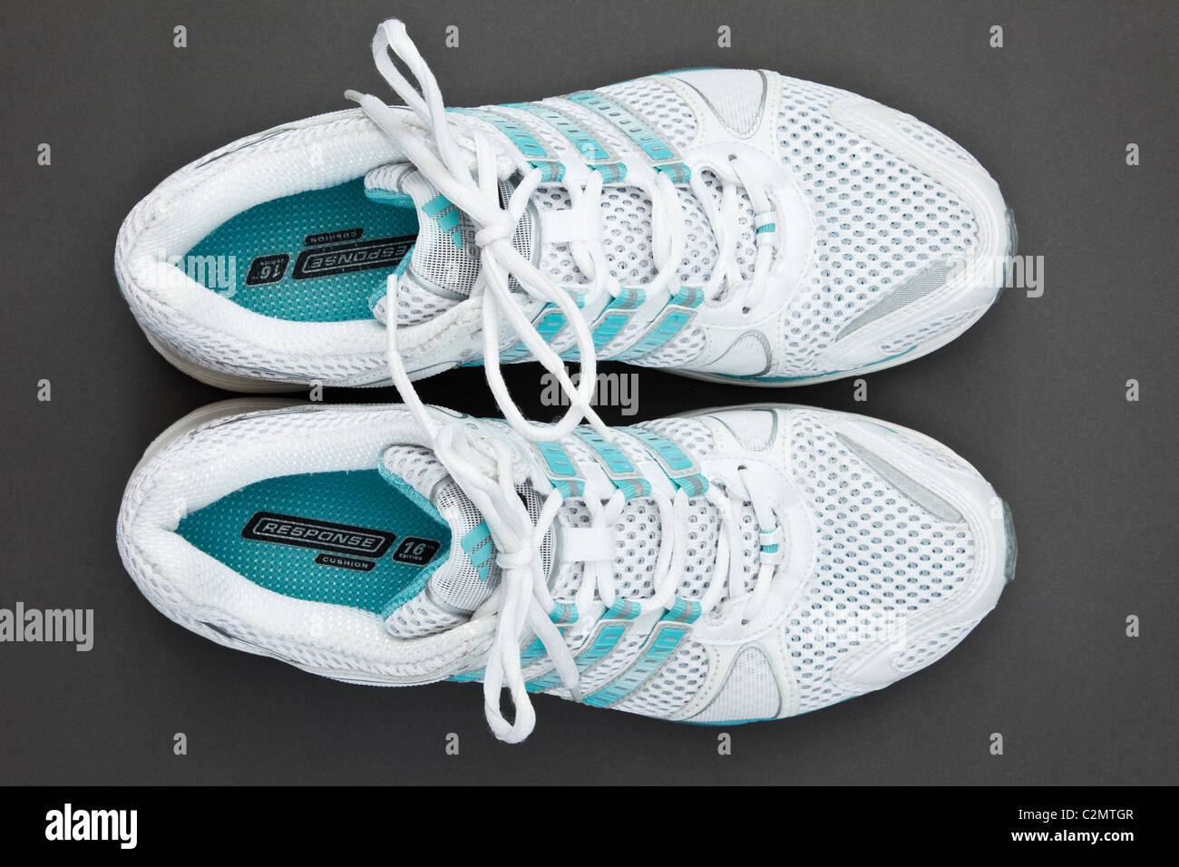 A pair of women's new white and blue Adidas air cushion trainers ...