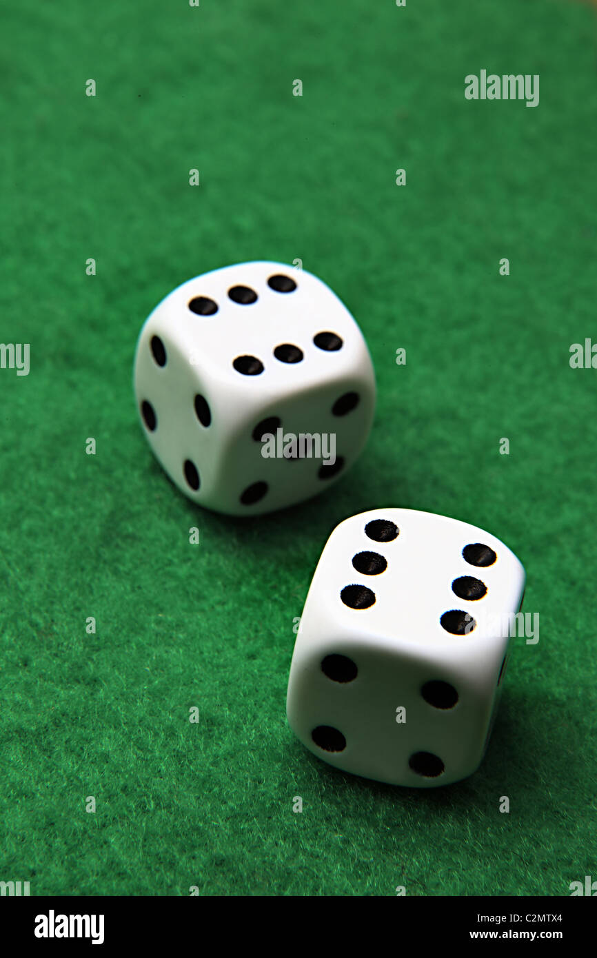 Double six on a pair of dice sitting on green felt - Stock Image