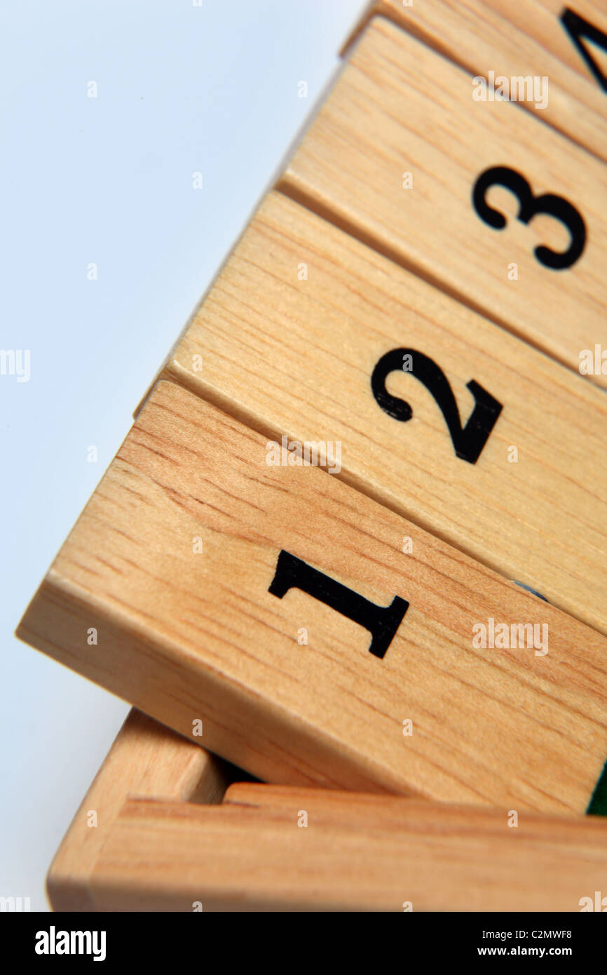 Numbers 1-3 on a wooden board game - Stock Image