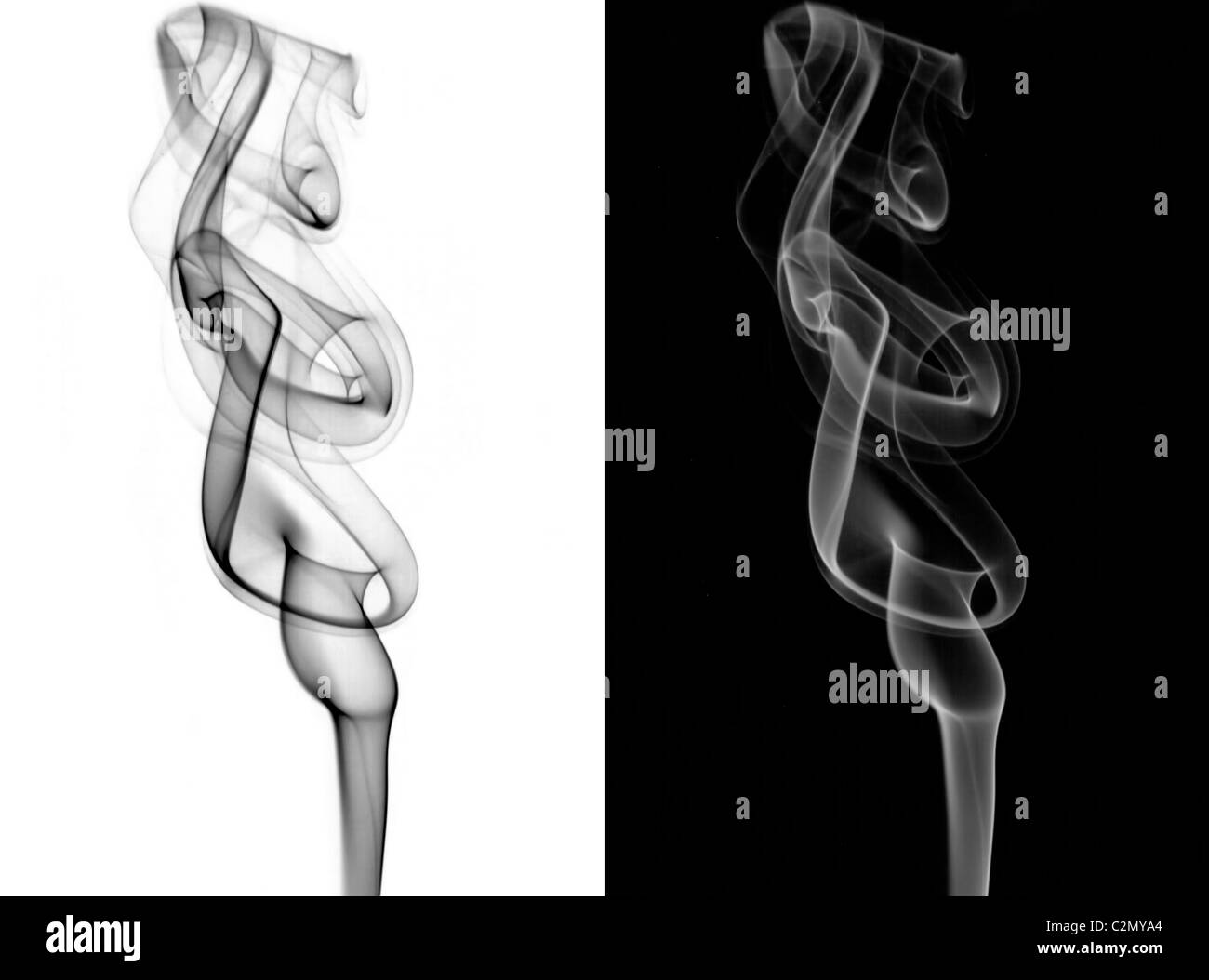 Smoke trails gelled with different colored lights - Stock Image