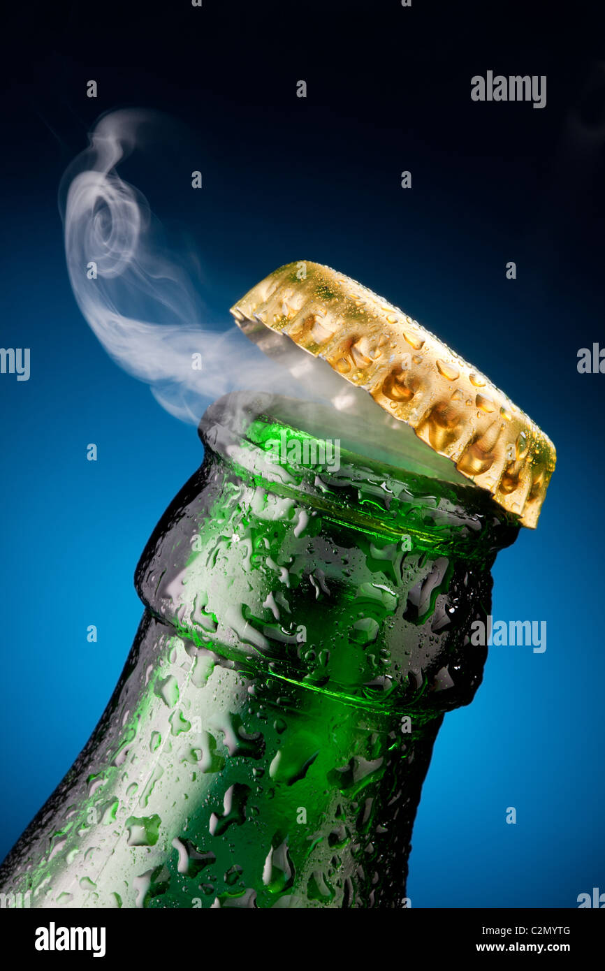 Opening of beer cap with the gas output - Stock Image