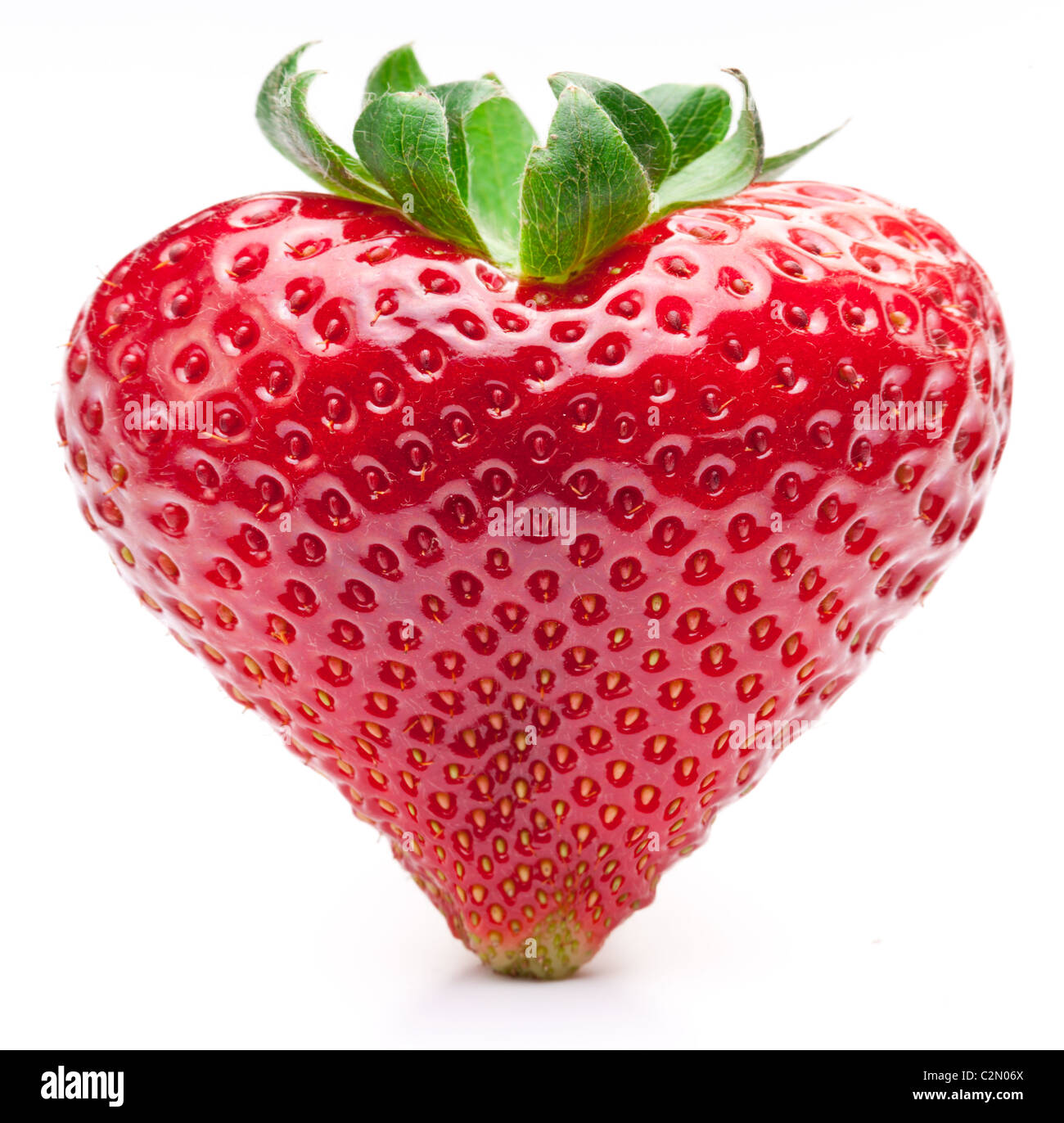 Strawberry heart. Isolated on a white background. - Stock Image