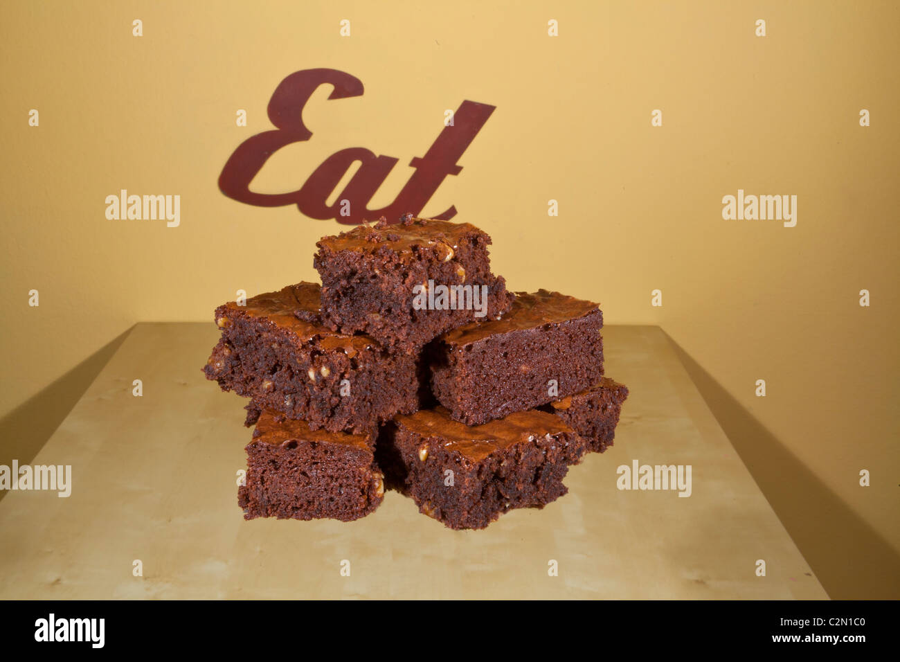 A stack of home made brownies with walnuts Stock Photo