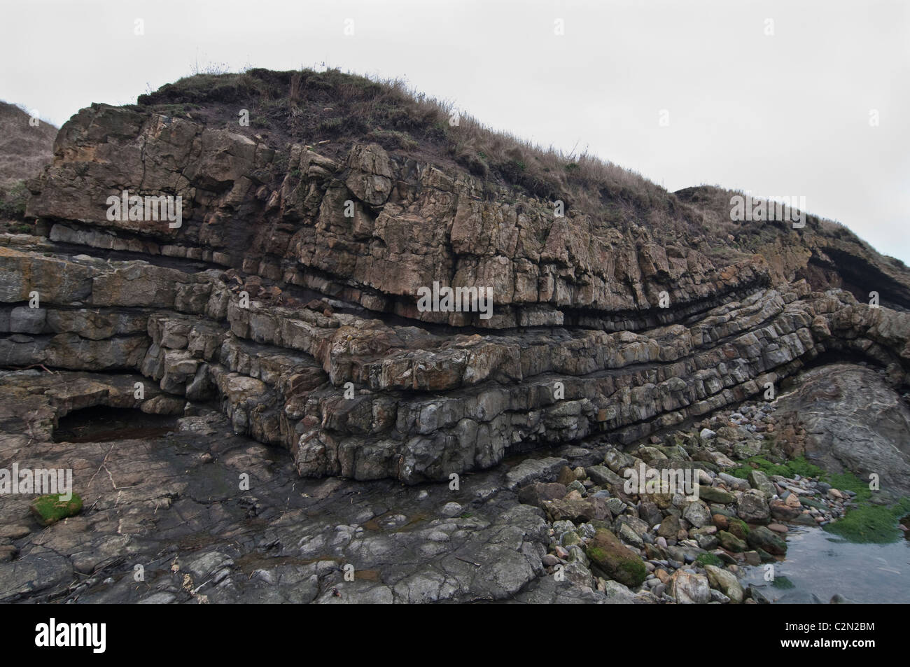 Volcanic magma rock formation at Cocklawburn, Northumberland, England, UK. - Stock Image