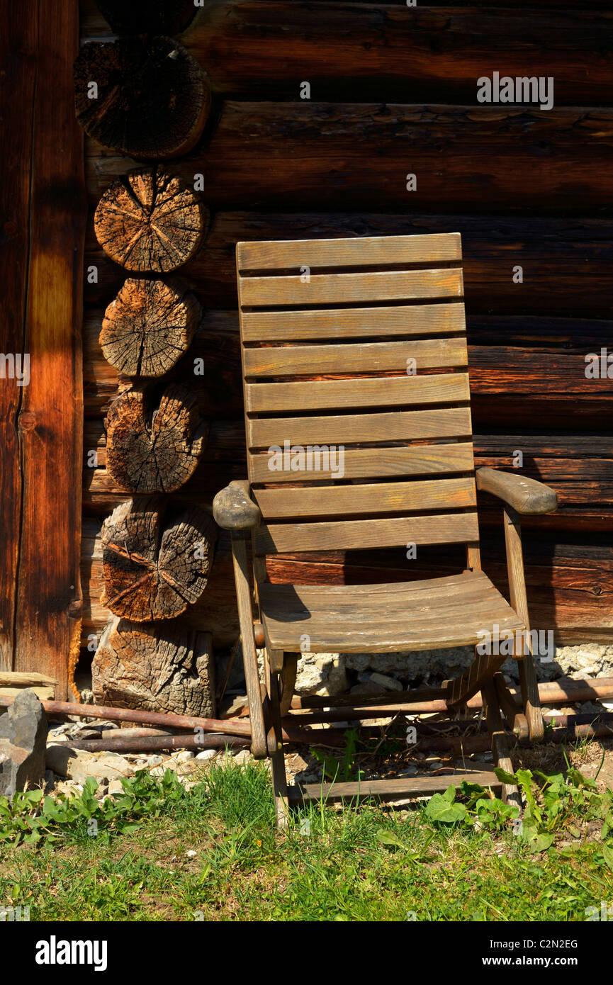 An old wooden folding chair at a mountain hut in Kleinsteg, Liechtenstein FL Stock Photo