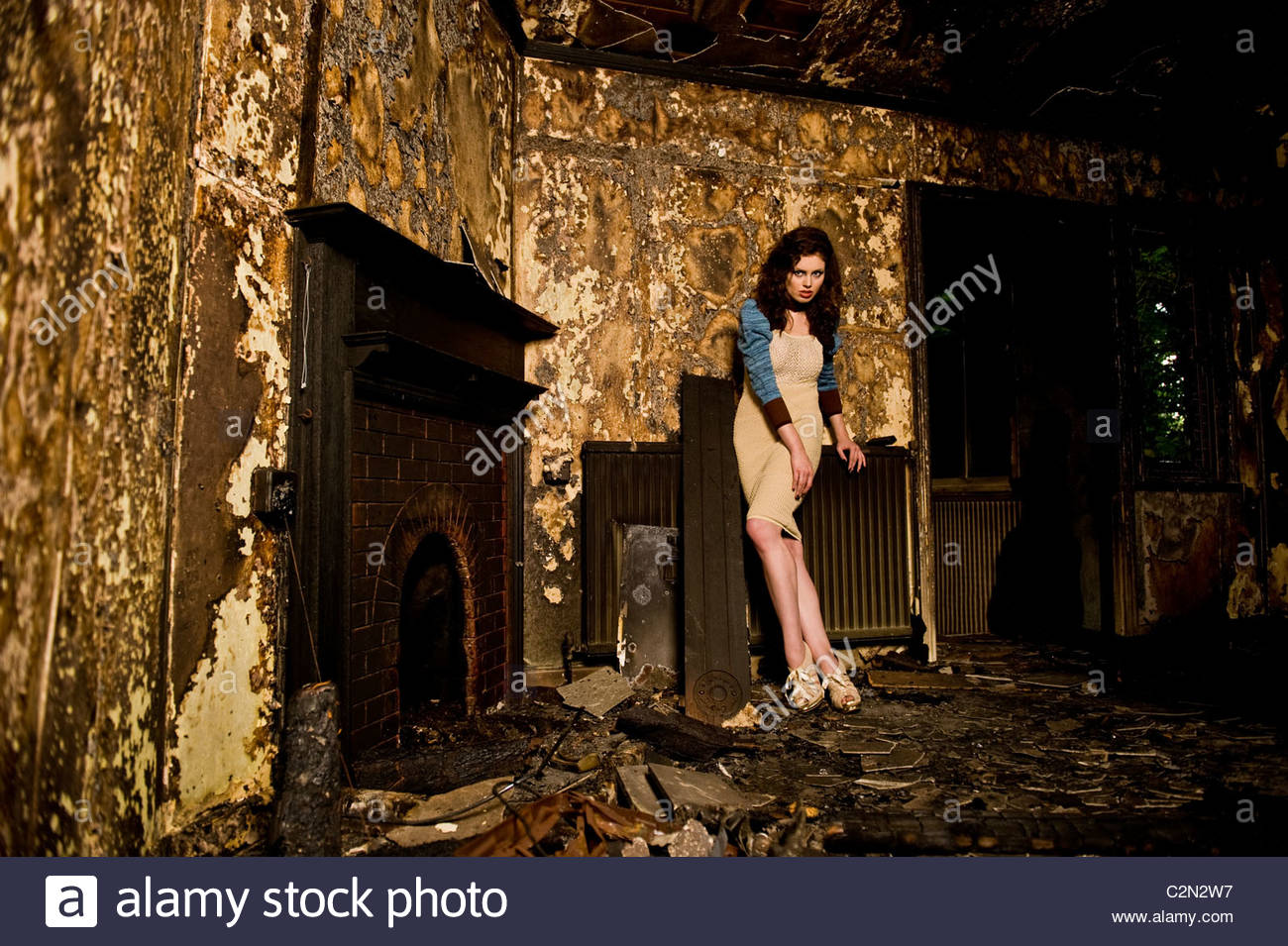 Caucasian Fashion Model in Burnt Building - Stock Image