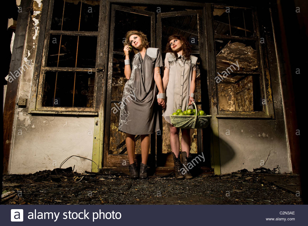 Caucasian Fashion Models in Burnt Building - Stock Image