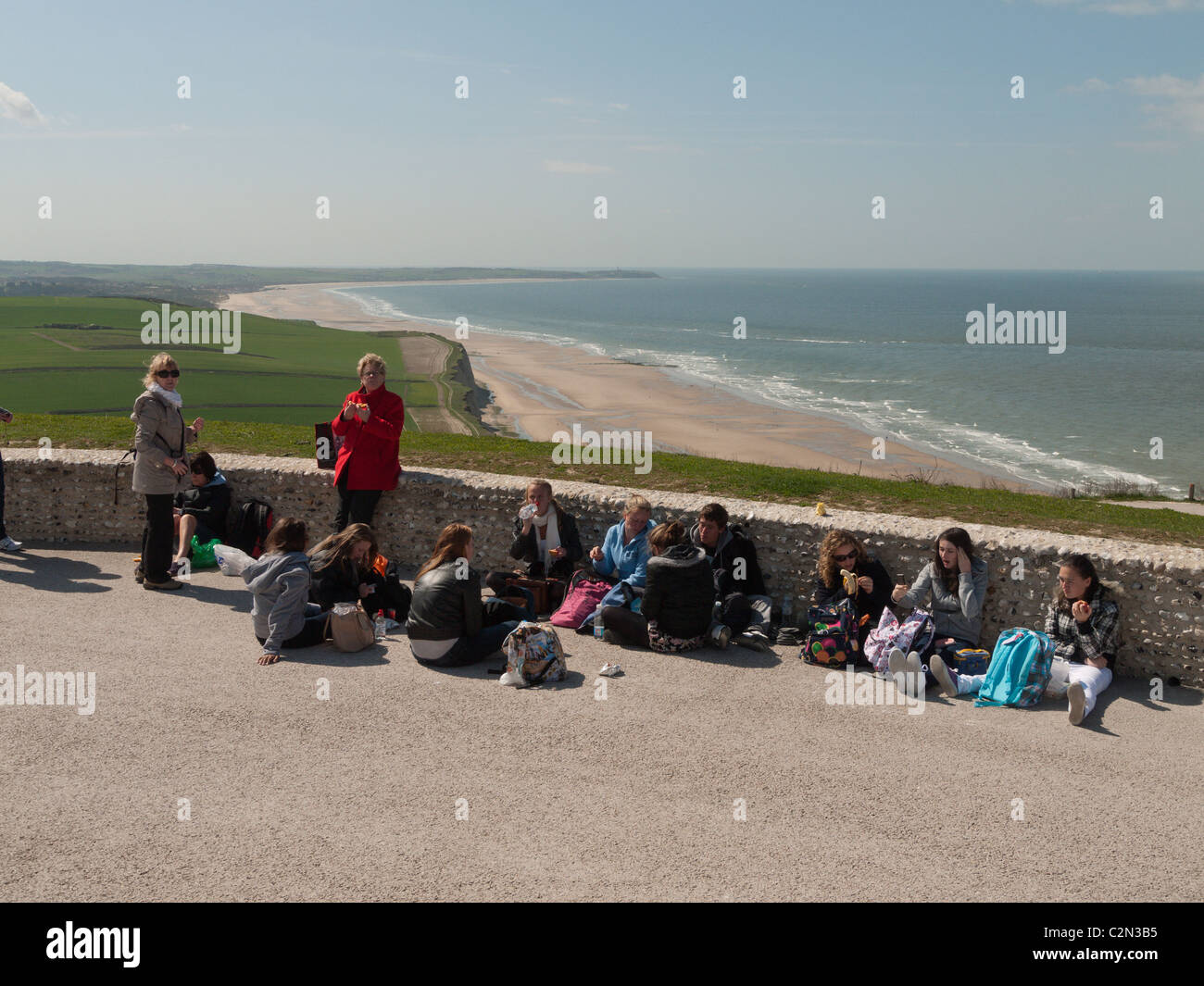 school party takes a break on the top of the cliffs at cap blanc nez, near Calais, France - Stock Image