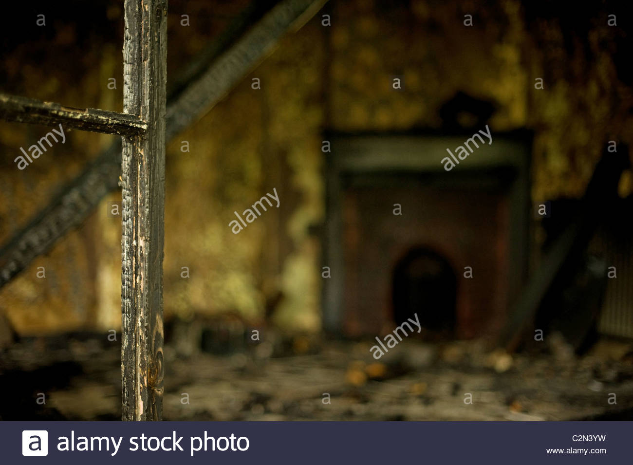 Abandoned fire damage room with a fireplace - Stock Image