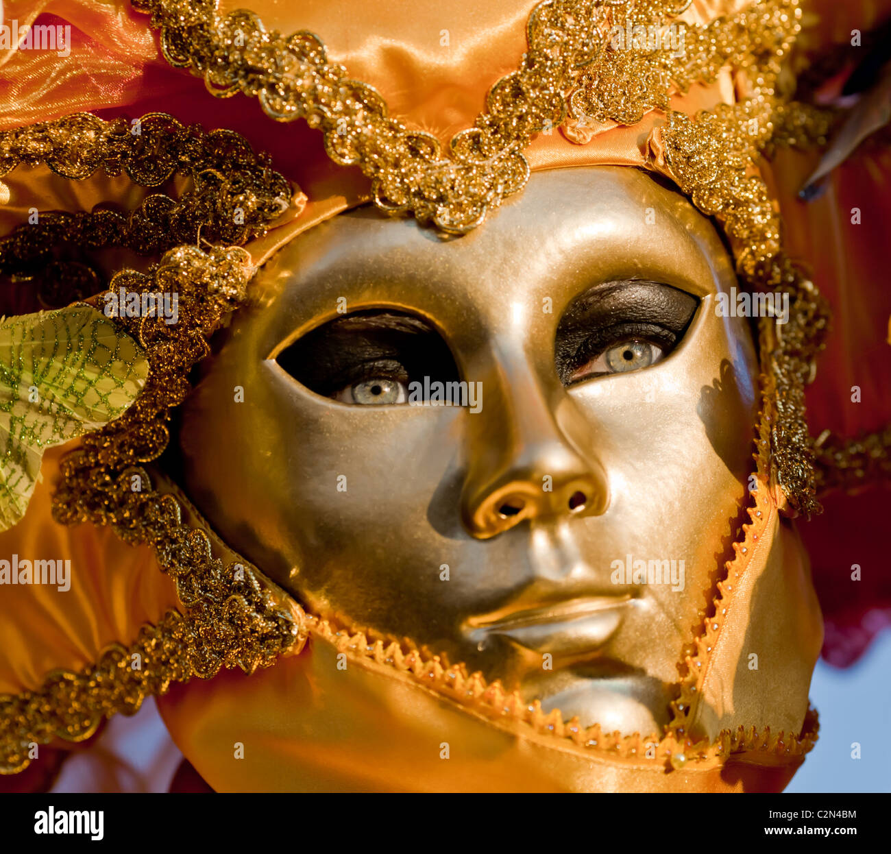 A woman wearing a golden mask during Venice carnival, Venice, Italy Stock Photo
