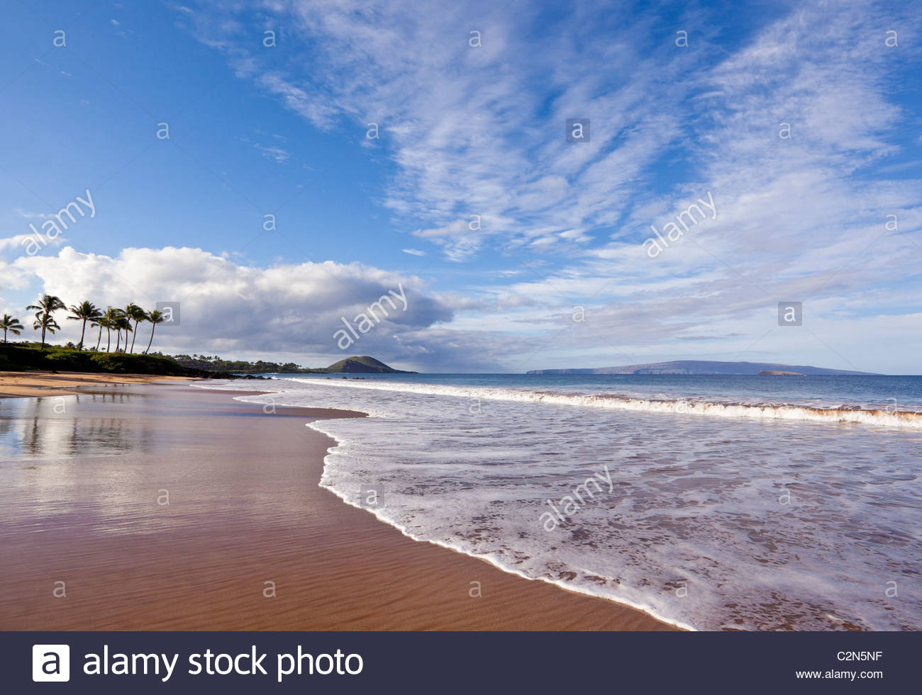 Gentle surf good for swimming on Po'olenalena Beach at Makena on the island of Maui in the State of Hawaii USA. - Stock Image