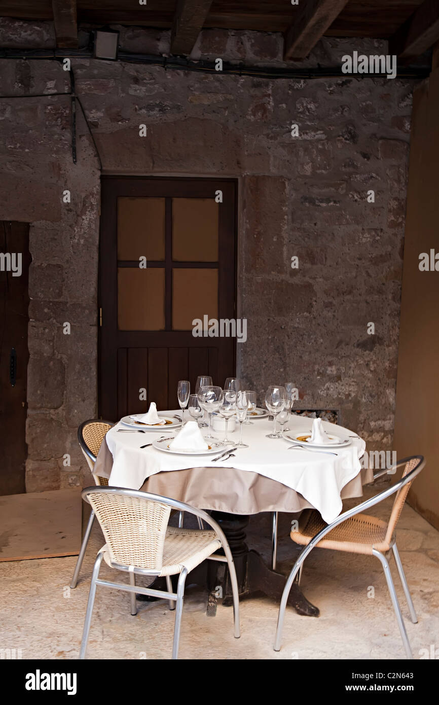 Table laid for meal outdoors Santa Pau Garrotxa Catalunya Spain - Stock Image