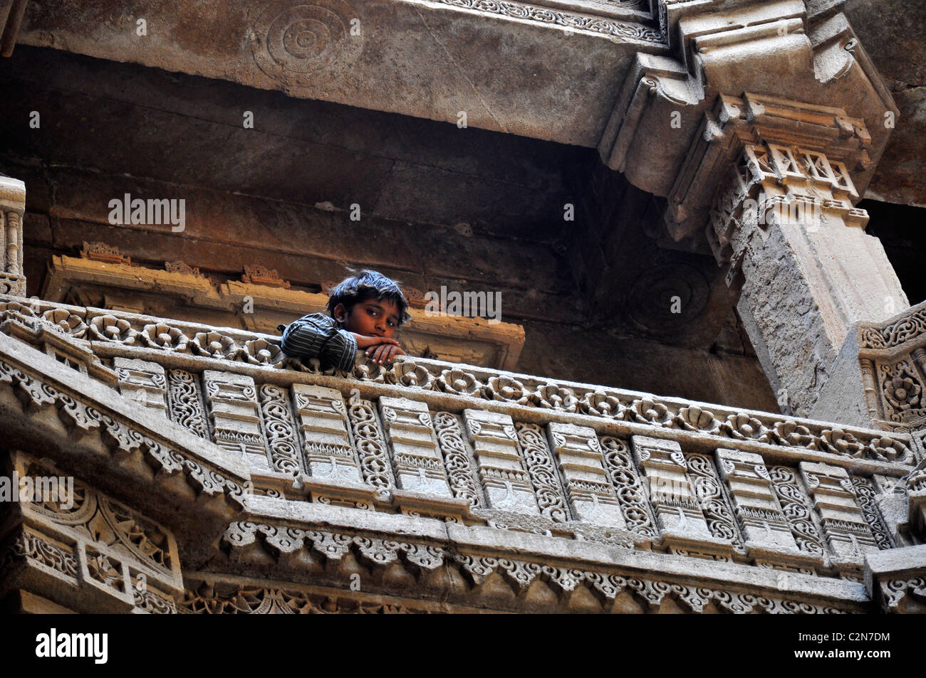 A boy looking from the Stepwell ( Adalaj vav) in Gujarath, India - Stock Image