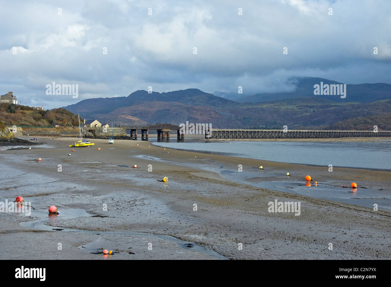 Barmouth Railway Bridge over the Mawddach Estuary at low tide in winter  Gwynedd mid Wales UK United Kingdom GB Stock Photo