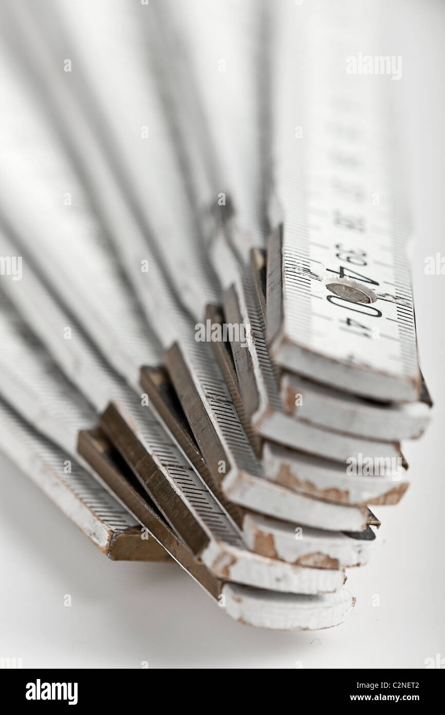 close up macro shot of a white folding rule - Stock Image