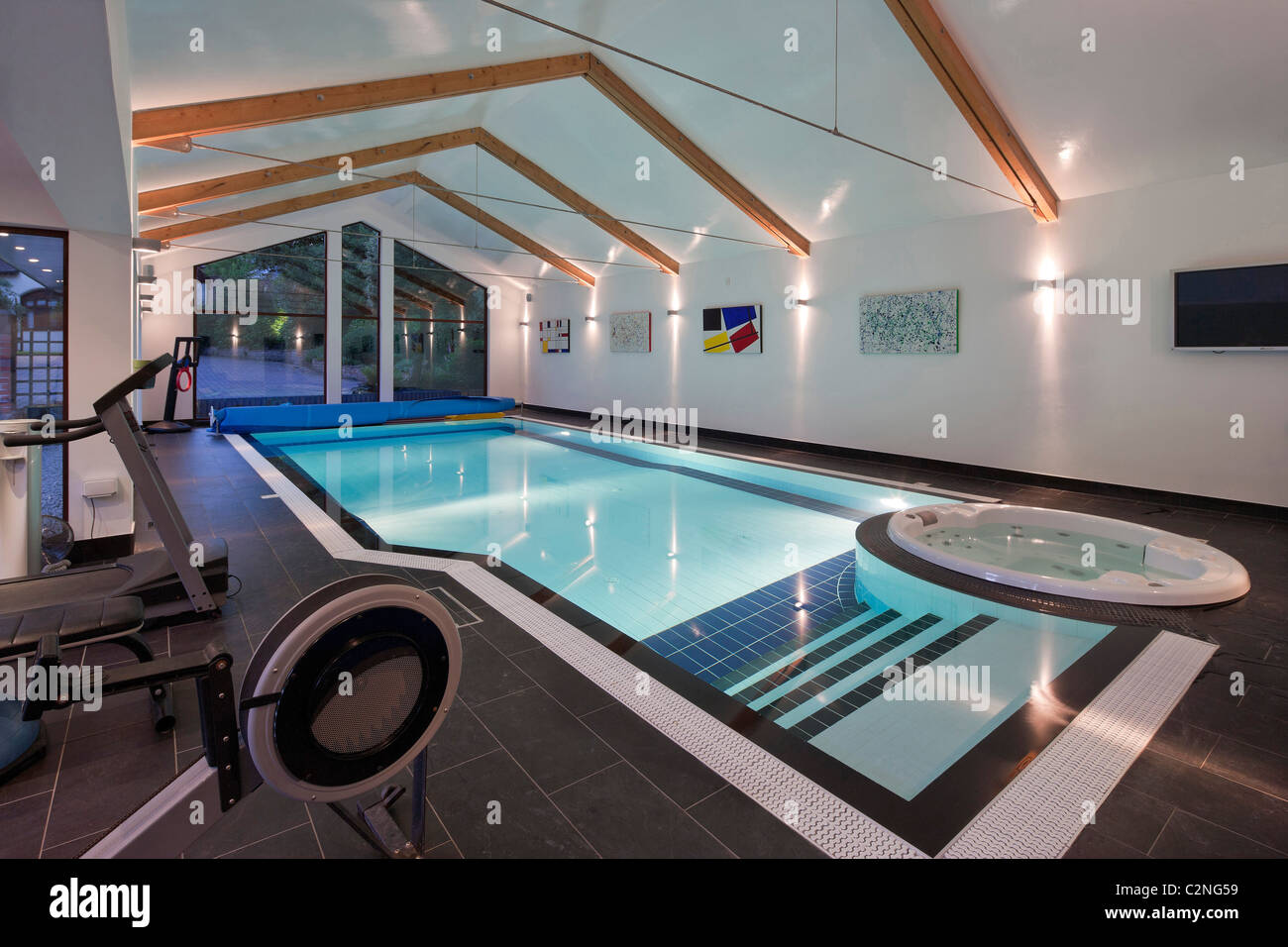 Pool house with swimming pool and gym - Stock Image