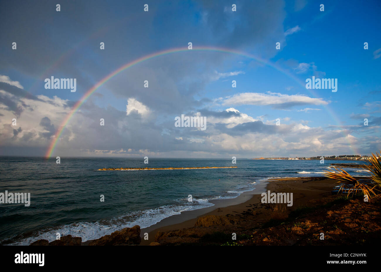 180 degree rainbow over the sea at paphos Cyprus after a heavy storm - Stock Image