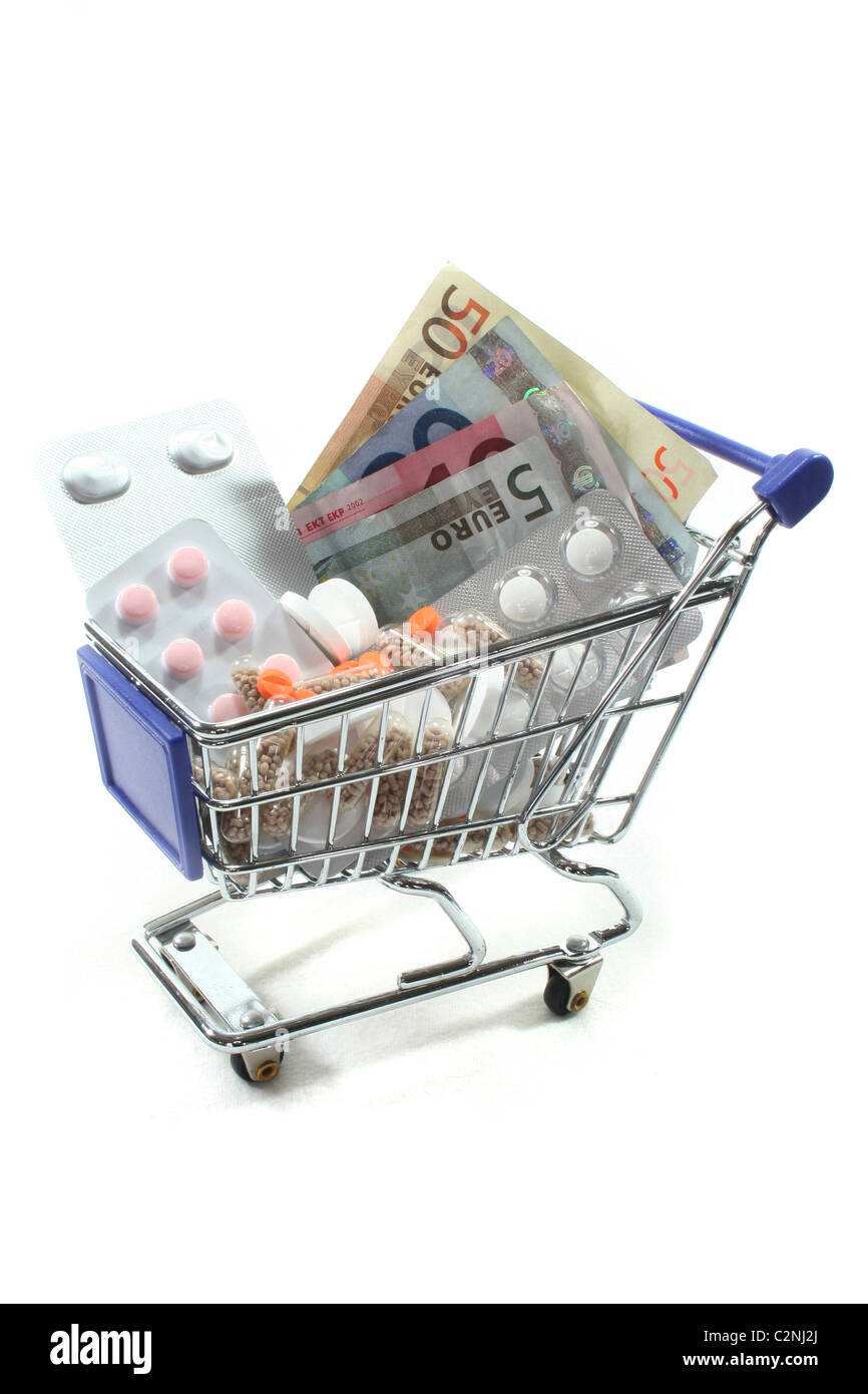 Shopping Cart with tablets and euro notes Stock Photo
