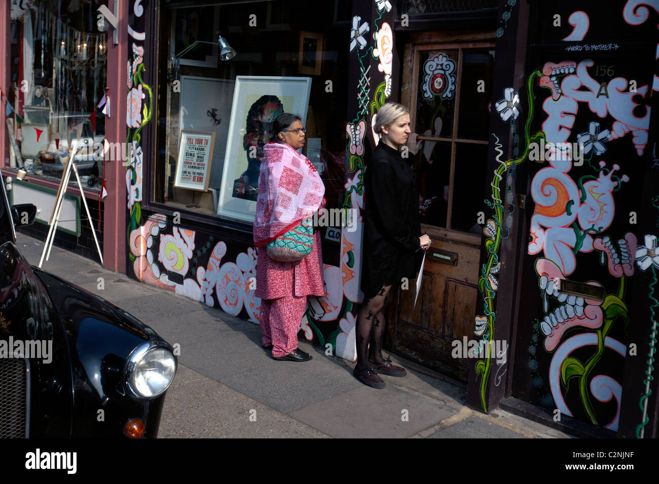 two women on columbia road in london - Stock Image
