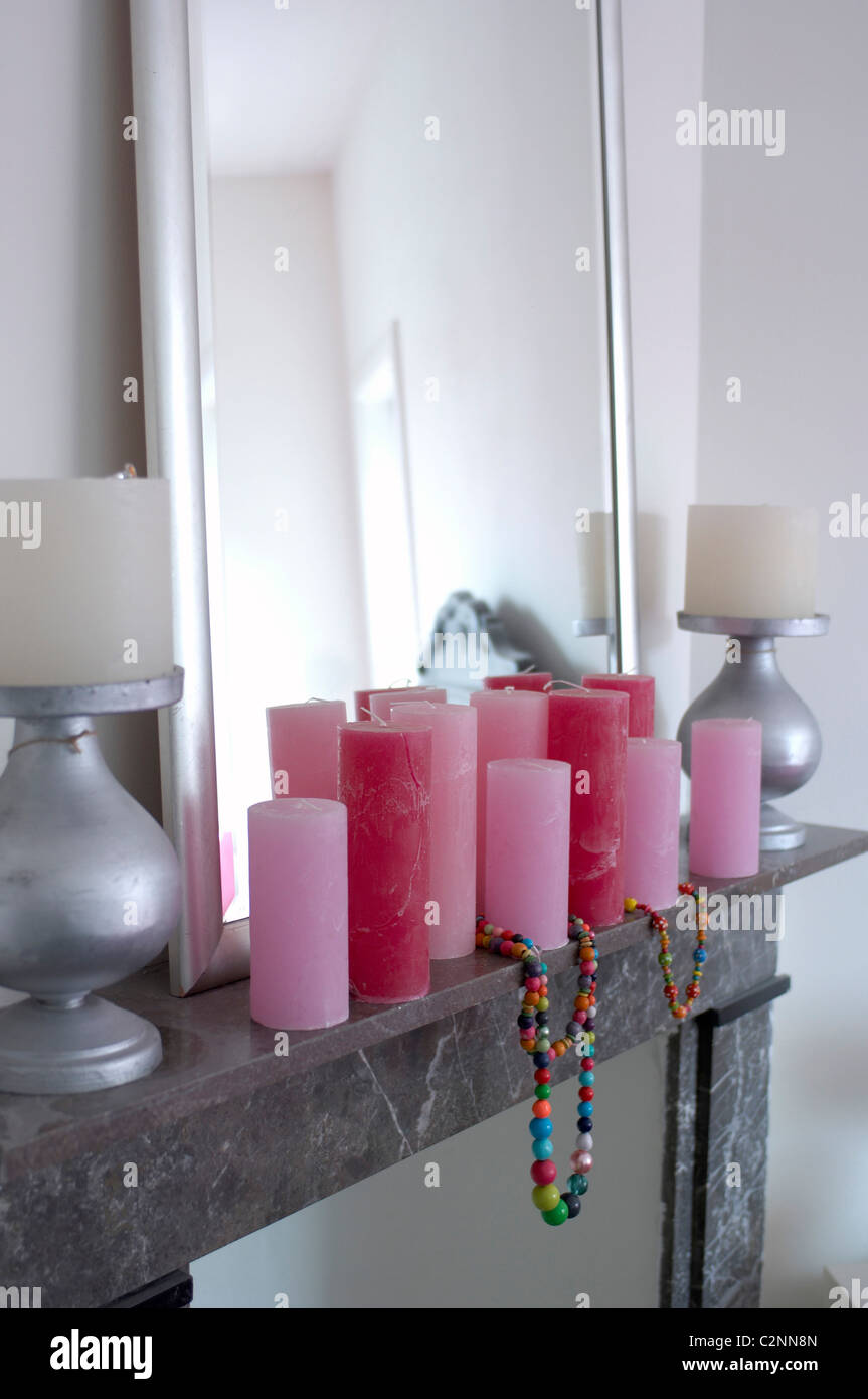 Pink And White Candles And Necklace Of Coloured Beadson Grey Marble Stock Photo Alamy