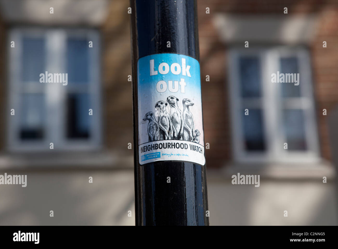 Look out neighbourhood watch sign on post - Stock Image