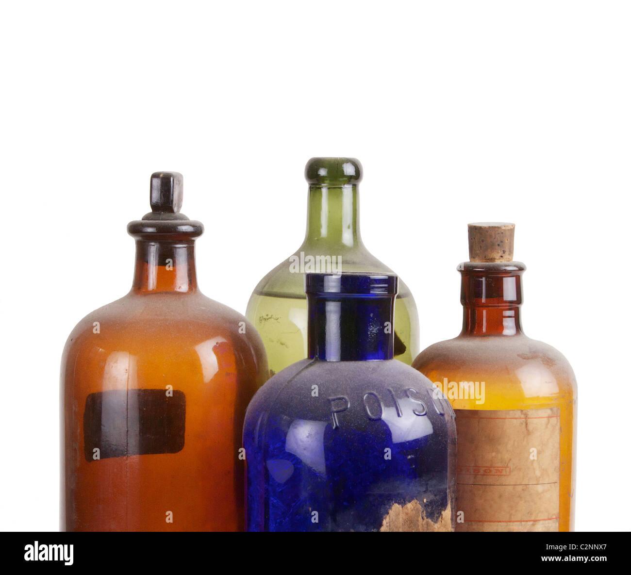 Old Blue Glass Medicine Bottles, Green Glass Glass Medicine Bottles, and Brown Glass Medicine Bottles, on white background Stock Photo