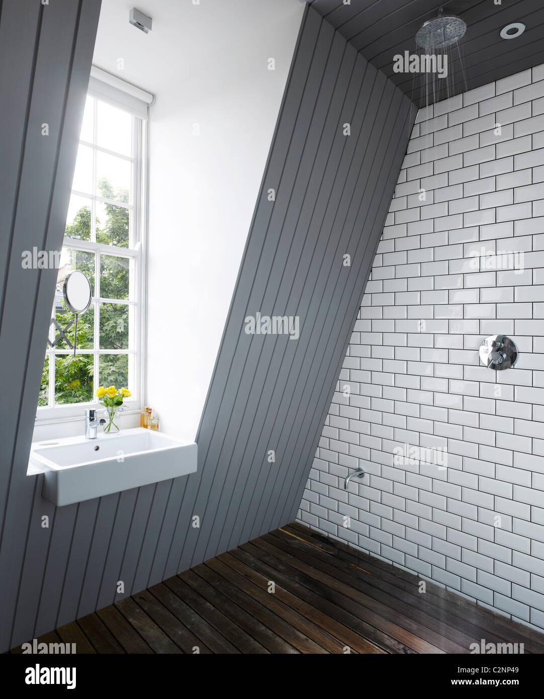 Bathroom in Attic Extention of Islington House by Dominic McKenzie. - Stock Image