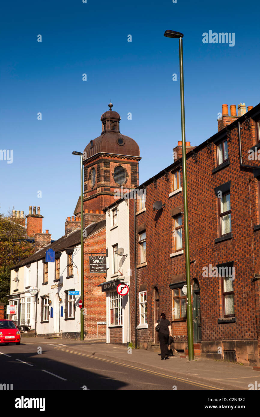 UK, England, Staffordshire, Leek, Stockwell Street, Nicholson Institute tower above elegant town centre houses - Stock Image
