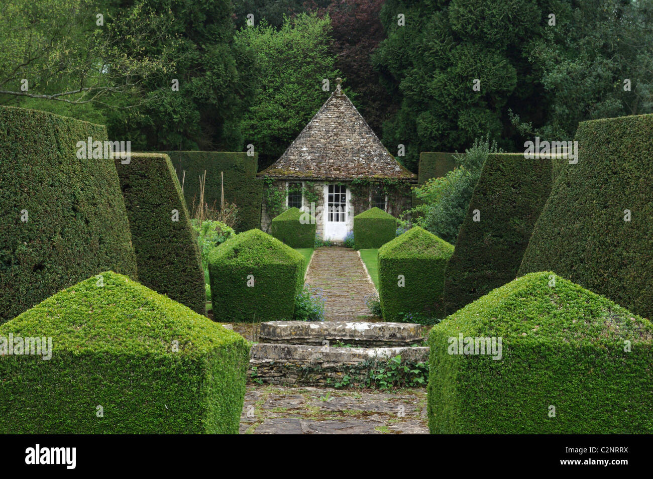A formal garden at Rodmarton Manor, an Arts and Crafts house near Cirencester, Gloucestershire, UK - Stock Image