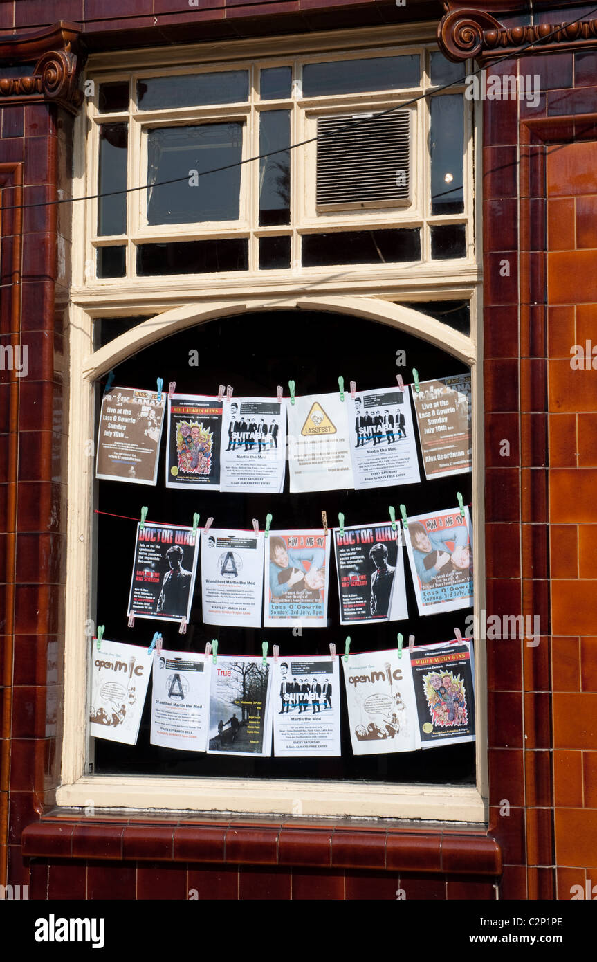 Window displaying forthcoming acts at the Lass 'o' Gowrie  iconic Manchester pub.Real ale,pub grub and live - Stock Image