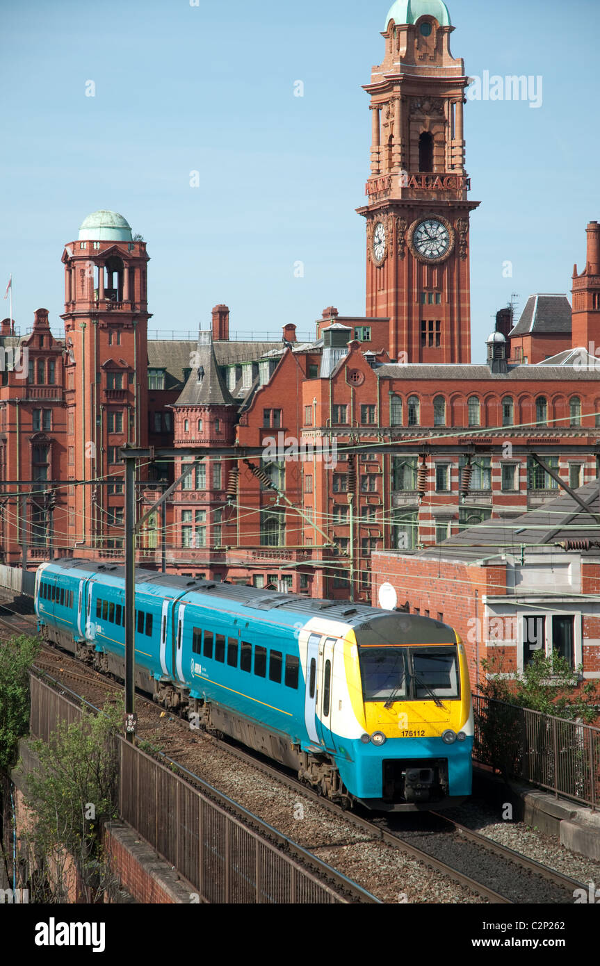 Arriva train city centre Manchester, with the Palace Hotel in the background. - Stock Image