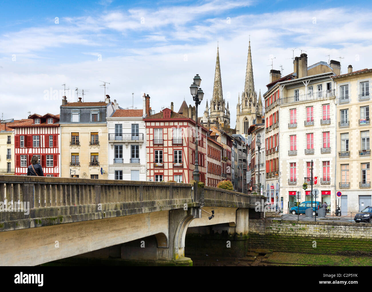 Traditional houses along banks of the River Nive Grand Bayonne with the Cathedral behind, Bayonne (Baiona), Cote - Stock Image