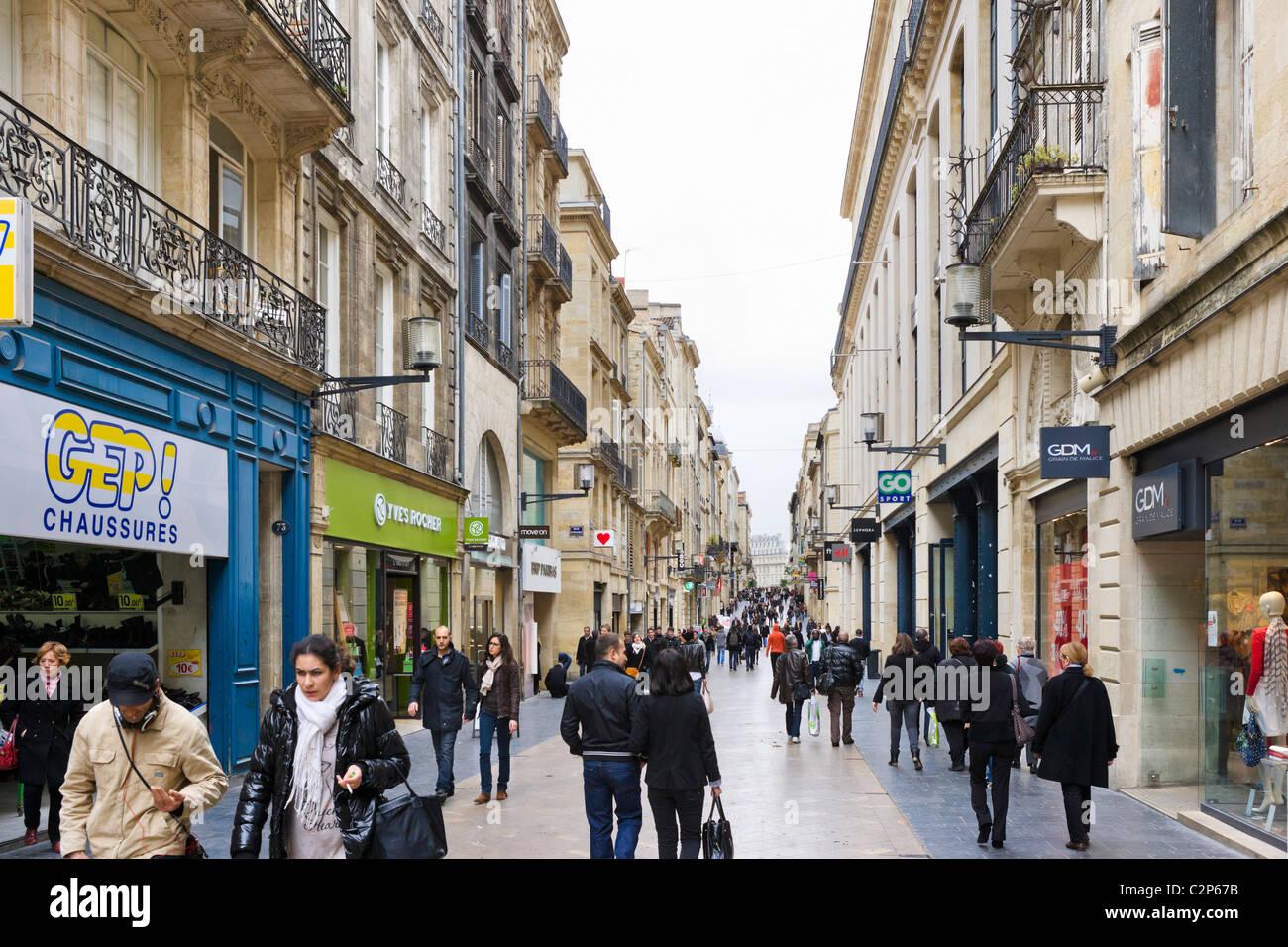 Shops on Rue Ste Catherine in the city centre, Quartier St Pierre, Bordeaux, Aquitaine, France - Stock Image