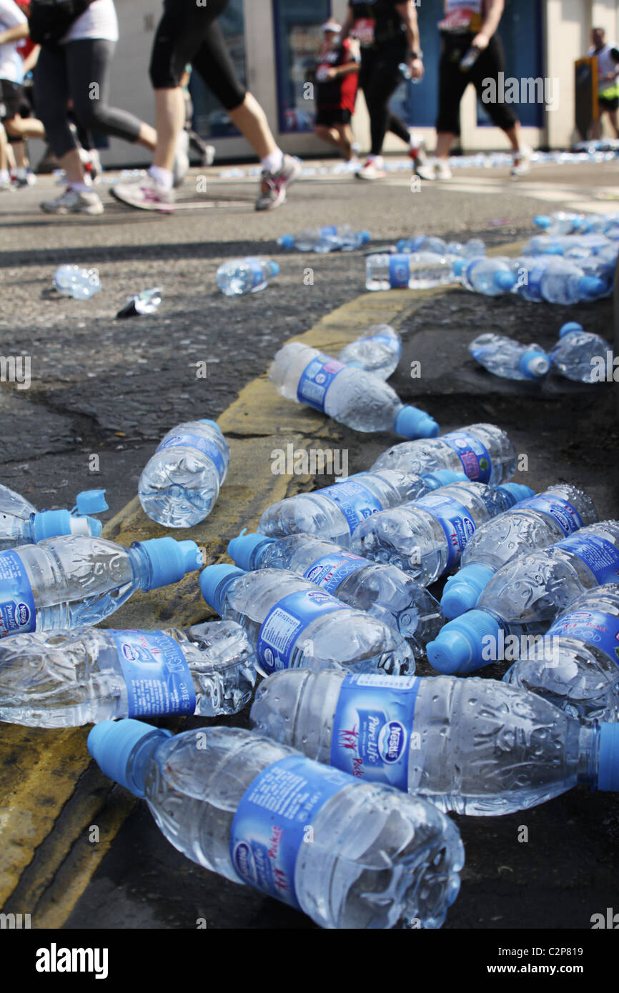 Discarded plastic water bottles on route of London Marathon - Stock Image