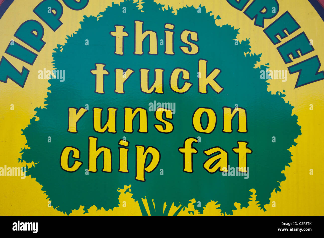 This truck runs on chip fat sign on side of Zippo circus lorry - Stock Image