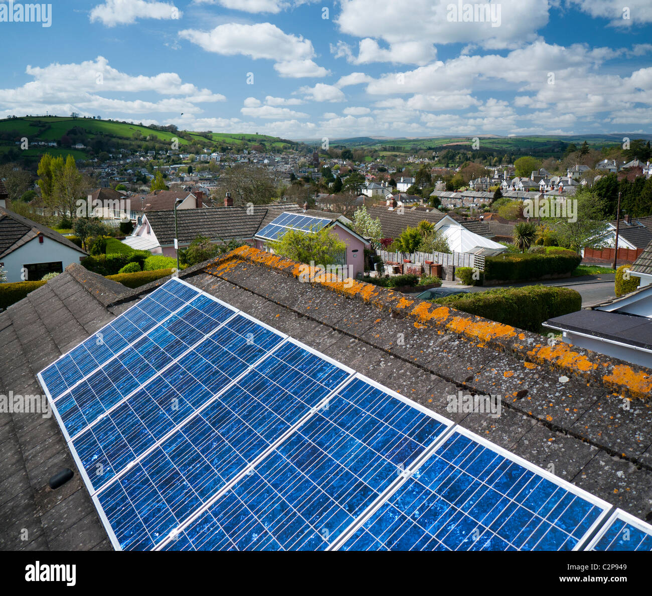Solar panels on the roof of a house in Totnes Devon UK - Stock Image