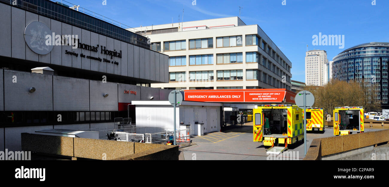 Back doors open on Accident and Emergency NHS ambulances waiting outside entrance to A&E department St Thomas - Stock Image