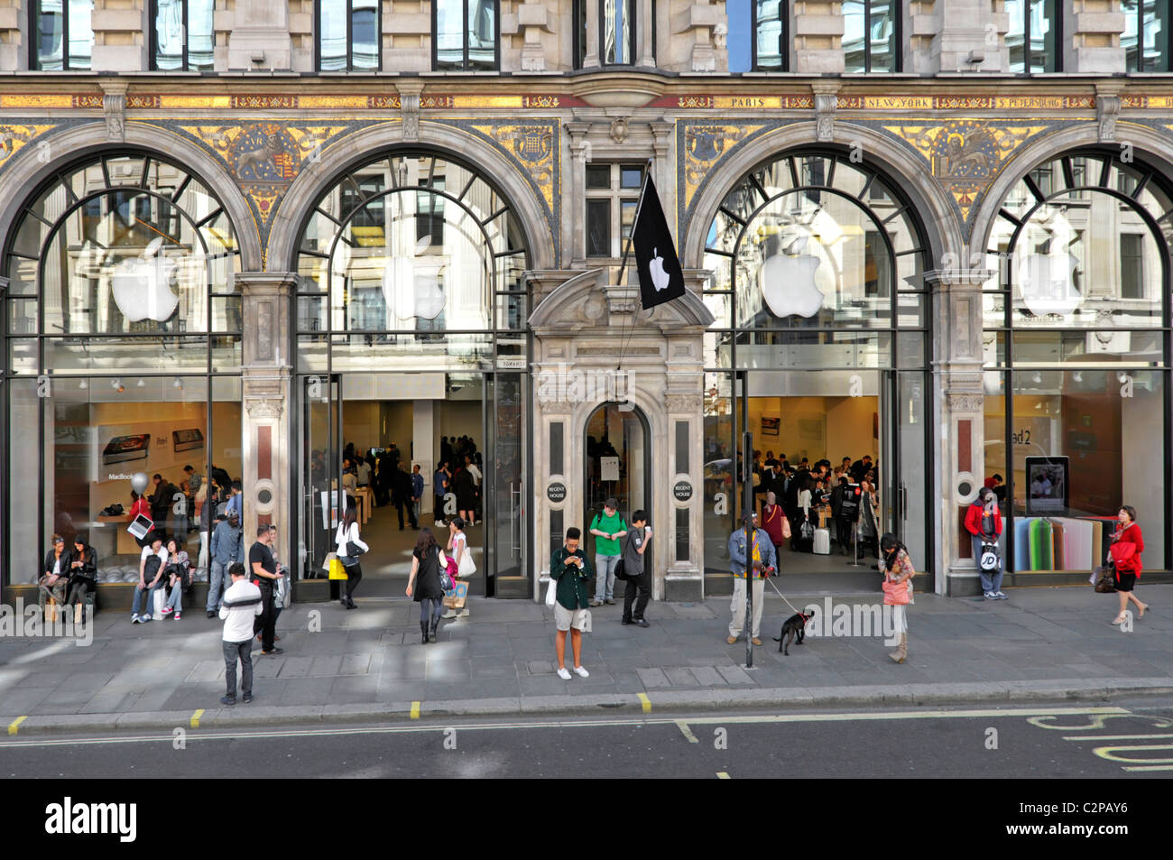 People on pavement outside the Apple American technology business flagship retail store in Regent Street London Stock Photo