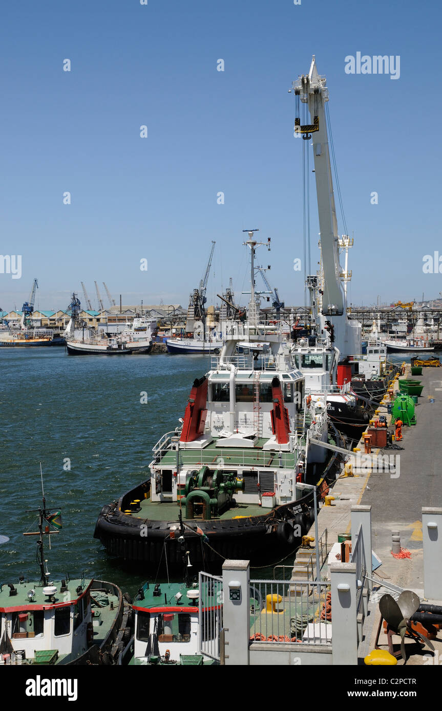 Ocean going tugs & floating crane alongside Port of Cape Town South Africa - Stock Image