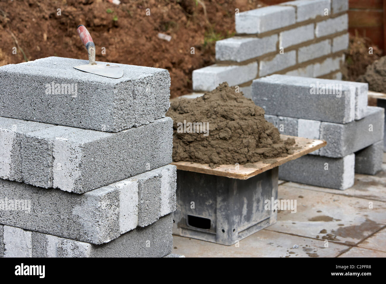 Bricklaying wall with half cement breeze blocks building a for How to build a block house