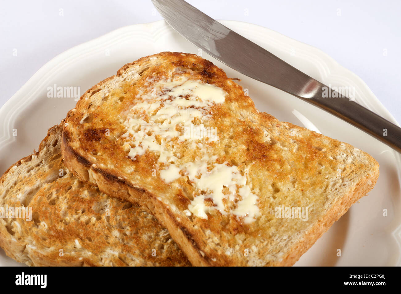 Buttered slices of Hovis hearty oat bread (toasted) - Stock Image