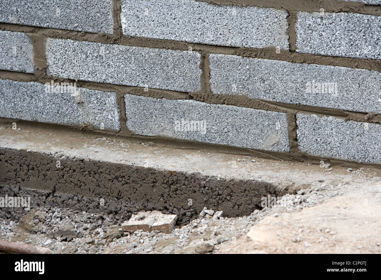 Bricklaying wall with half cement breeze blocks building a for Block wall foundation