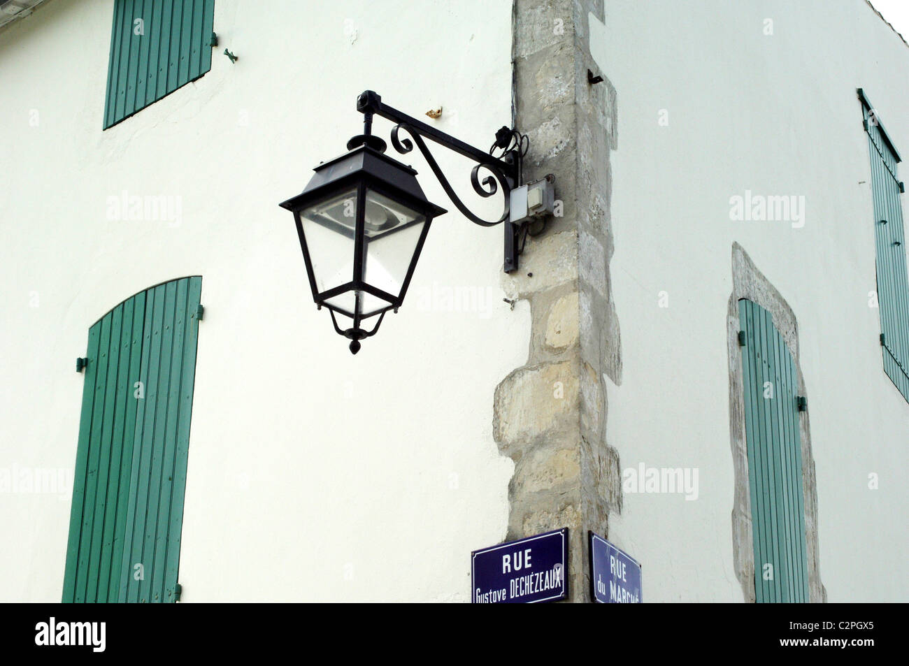 Streetlamp and shuttered windows, Il de Re, France - Stock Image