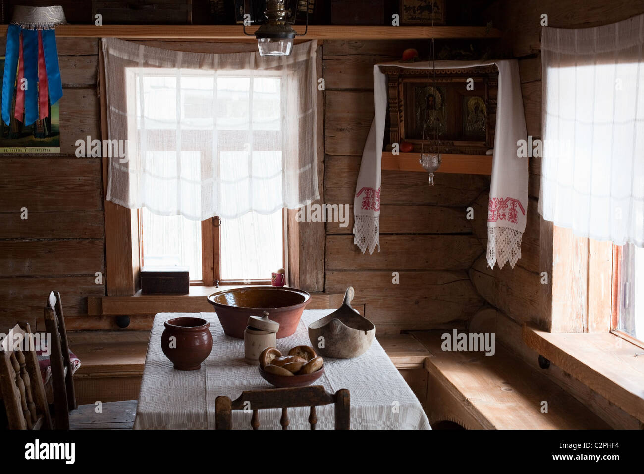 Russian domestic room in ancient wooden house. Museum interior - Stock Image