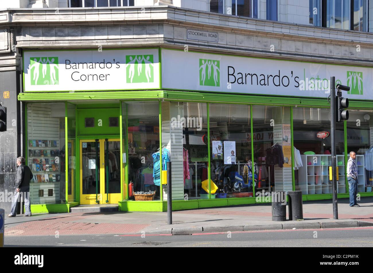 Barnado's corner Brixton secondhand clothes books furniture charity shop good cause - Stock Image