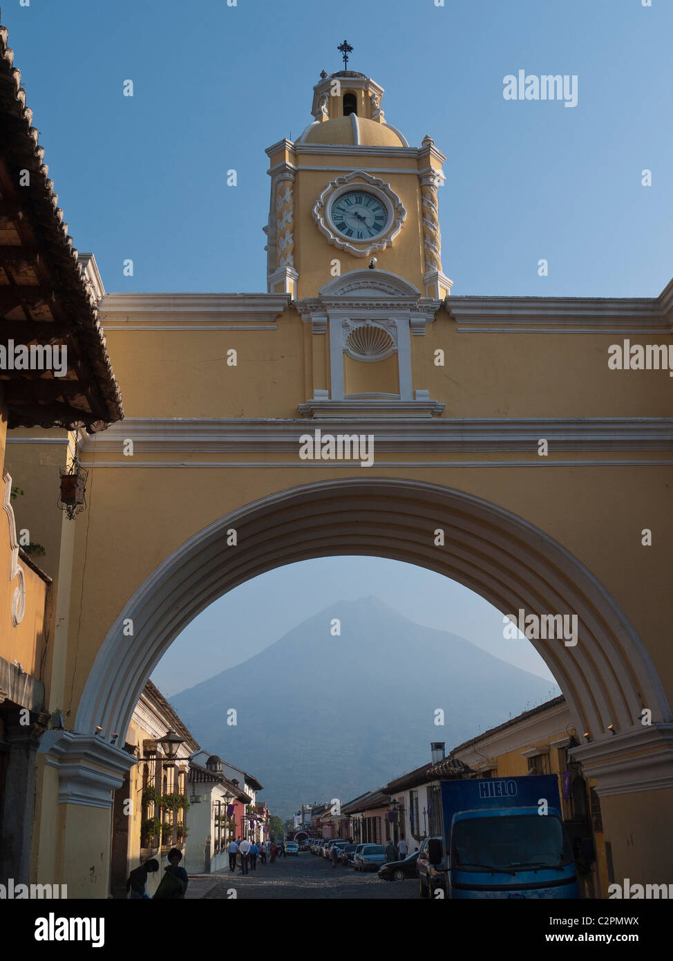 A detail of one of the historic church structures in Antigua, Guatemala with the archway framing the volcano in - Stock Image