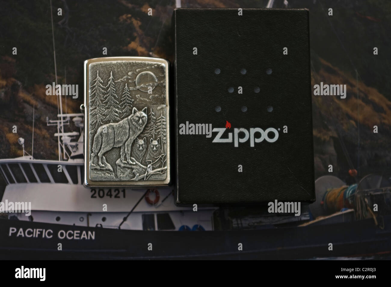 zippo lighter, timber wolf, boat background - Stock Image